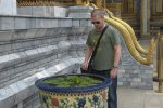 Greg contemplates the floating flowers. Grand Palace, Bangkok.